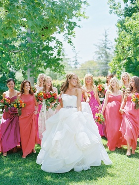 Bride in Vera Wang wedding dress with bridesmaids in pink and orange mismatched dresses