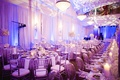 Ballroom reception with silver accents and bright lighting