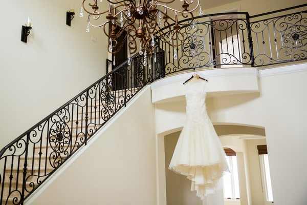 liancarlo gown with sweetheart neckline flower details, tulle a-line skirt hangs from staircase