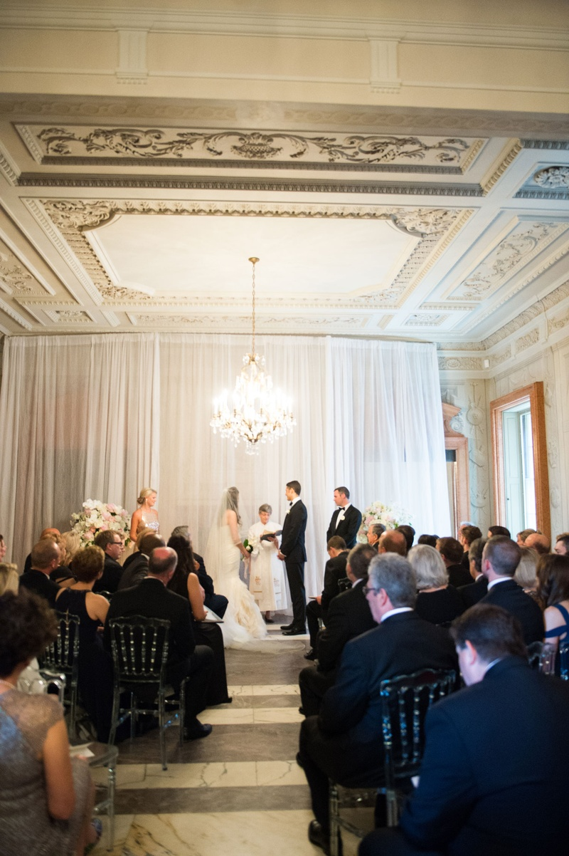 Ceremony in Washington DC at Anderson House simple decor chandelier