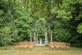 wedding ceremony garden venue in france wood vineyard chairs gazebo columns iron arch greenery