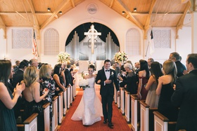 church wedding recessional, bride in romona keveza asymmetrical gown