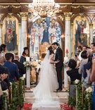 wedding ceremony greek orthodox cathedral gold foil chandelier greenery church pews
