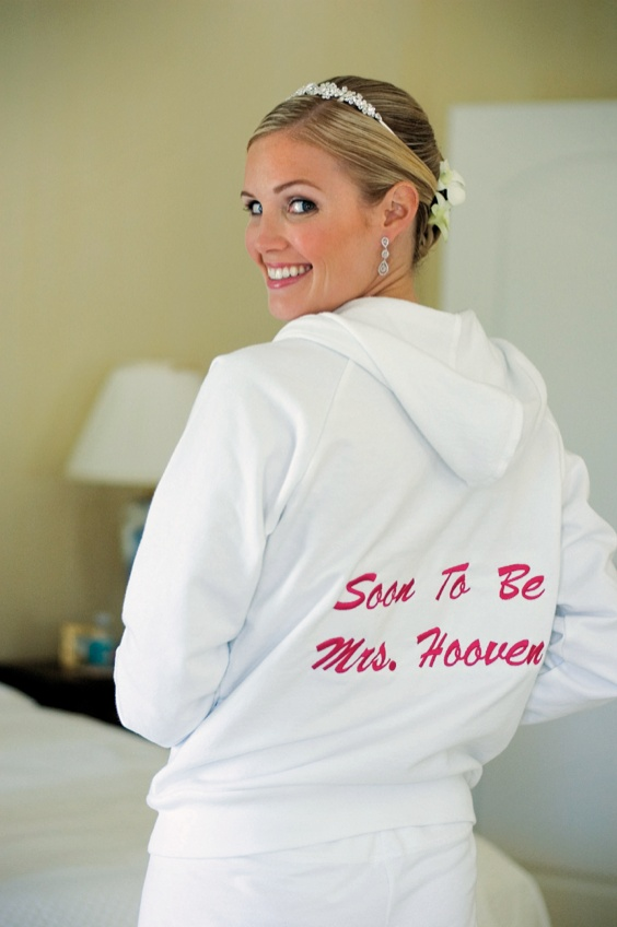 "White sweatshirt featuring words ""soon to be mrs"" in pink on back"