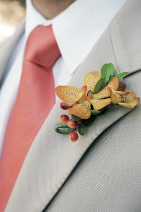 Groom's wedding boutonniere with yellow orchid