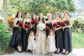 bride bridesmaids flower girls ladies of bridal party black dresses white red bouquets wedding