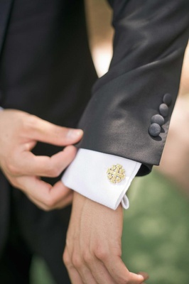 Groom wearing Vatican gold Jerusalem cross cufflinks