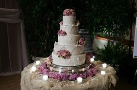 Intricate confection design with purple flowers