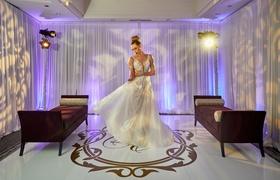 model bride twirling designer gown pallas couture australian bridal shop plunging neckline overskirt