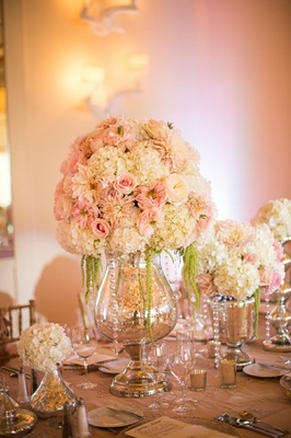 Glass vase centerpiece with dahlias and roses