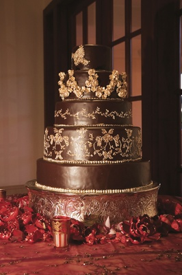 Five layer dark chocolate cake with gold leaf pattern