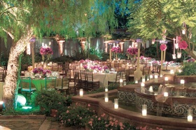 Evening reception with pink flowers and candlelight