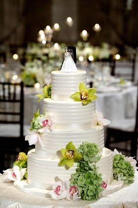 Confection topped with fresh flowers and topper