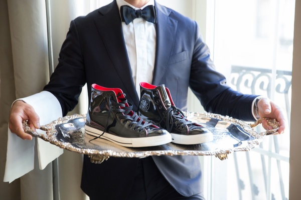 Black white red leather converse on silver platter groom
