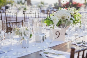 Wood table with white runner and brown table number