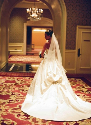 Crystal-embellished back bustle bridal gown
