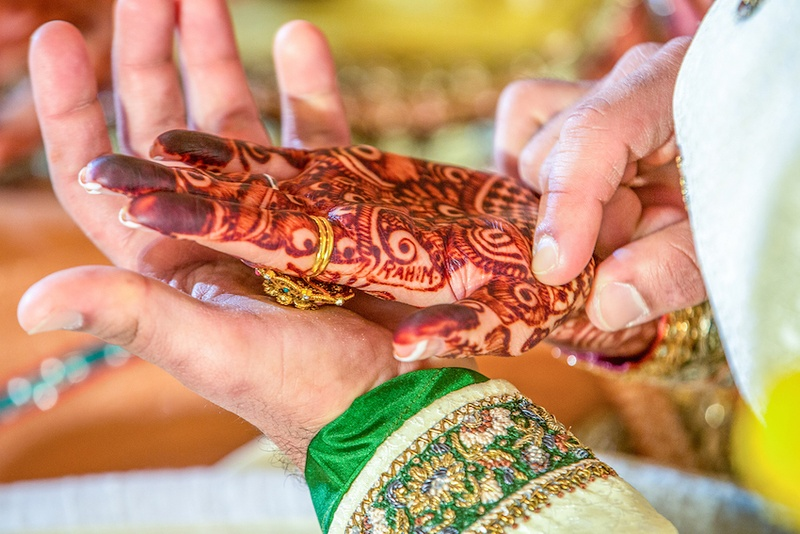 Intricate Indian bridal mehendi on palm of hand