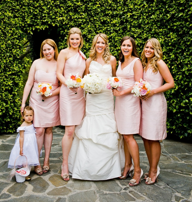 Bride with bridesmaids in mismatched pink gowns