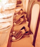 Comfortable sneakers for groomsmen with labels