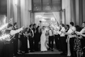 black and white photo of bride and groom grand exit sparklers second line