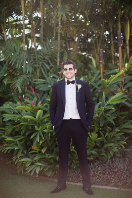 groom in ralph lauren purple label suit with hands in pocket, groom in round sunglasses