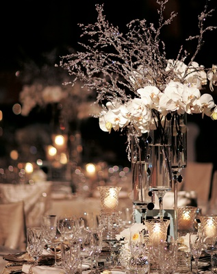 Outdoor night wedding reception with white and silver decorations