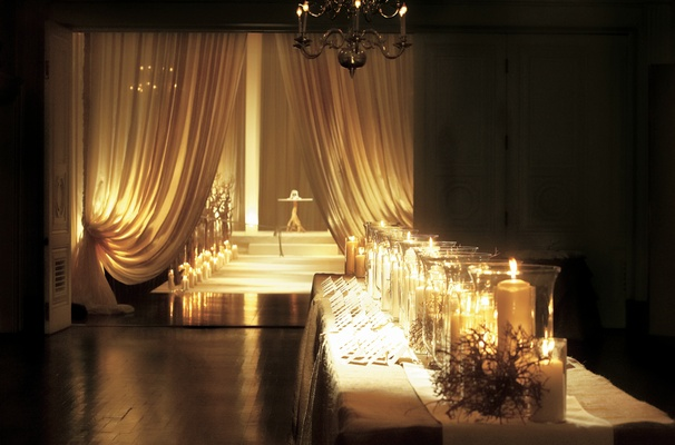 Table outside ceremony with escort cards and candles