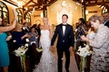 bride in marchesa wedding dress and groom in tuxedo church recessional