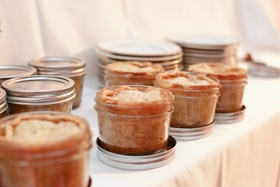 Mother of the bride-made apple pie in glass mason jars