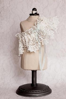Wedding day garter on mini dress stand with light blue ribbon
