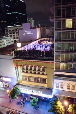 Rooftop wedding reception at Hotel Palomar, San Diego with purple lighting and couple's names