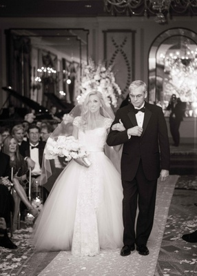 black and white photo of father walking daughter the bride down the aisle