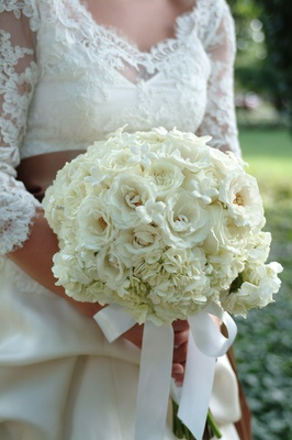 Bride holds bouquet with garden rose, hydrangea, and stephanotis flowers