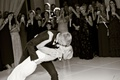 black and white photo of bride and groom kissing during first dance at wedding romantic dip