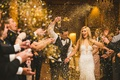 bride and groom at chicago wedding walking through guest tunnel gold glitter confetti