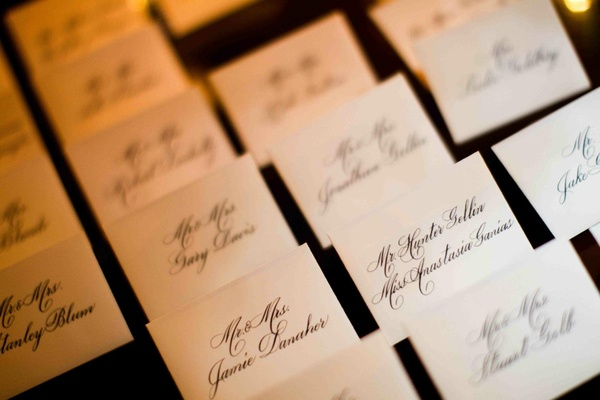 Seating cards with handwritten guest names