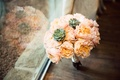 ombre peach garden roses with accents of green succulents for bridesmaid bouquet