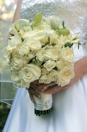 White rose bouquet with touches of greenery