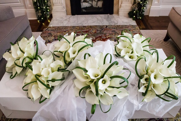 bridesmaid bouquets white calla lily flowers greenery arches in tissue paper bridal suite
