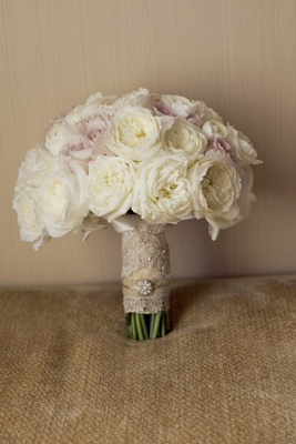 Garden roses wrapped in vintage-looking fabric