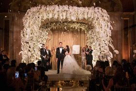 jewish wedding ceremony mirror aisle flower petal confetti toss orchid chuppah