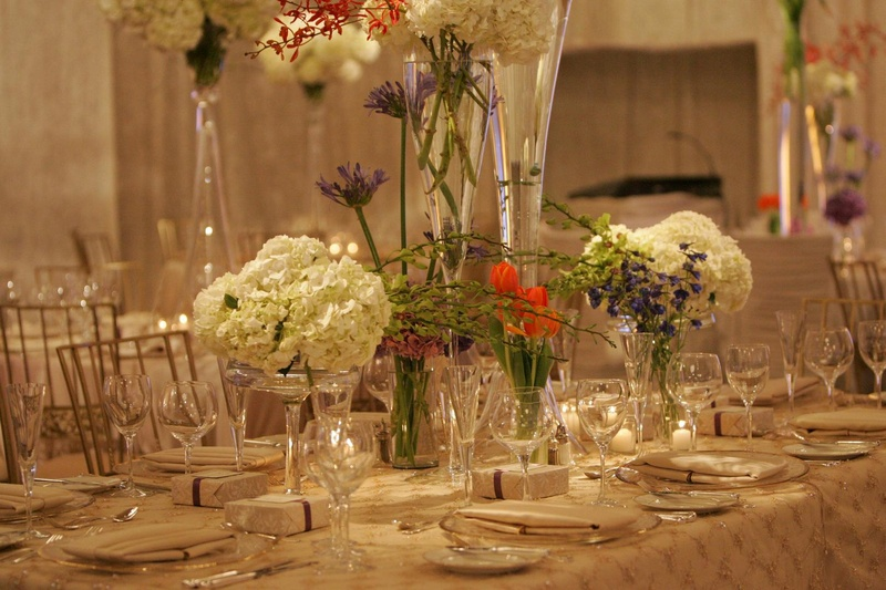 Tall glass vases filled with colorful flowers