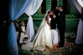Bride takes communion at nighttime wedding ceremony