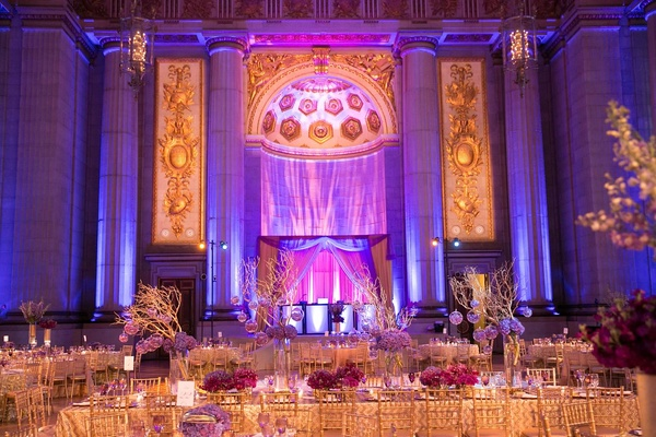 Dual ceremony with indian and western traditions inside weddings mellon auditorium wedding reception with purple lighting thecheapjerseys Image collections