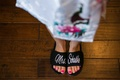 bride bright pink pedicure wearing black white bath slippers Mrs. Schaible married name