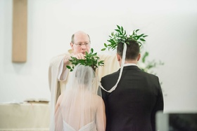 traditional greek crowning ceremony wedding crown of foliage leaves custom marriage church