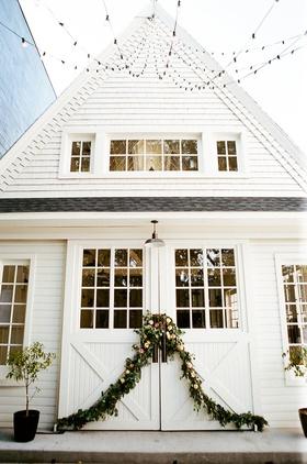 wedding reception venue lombardi house barn farmhouse style victorian home garland string lights