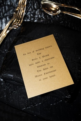 Gold card stating that instead of favors a donation had been made to a charity in the guest's honor