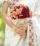 Bride's bouquet of red and orange flowers