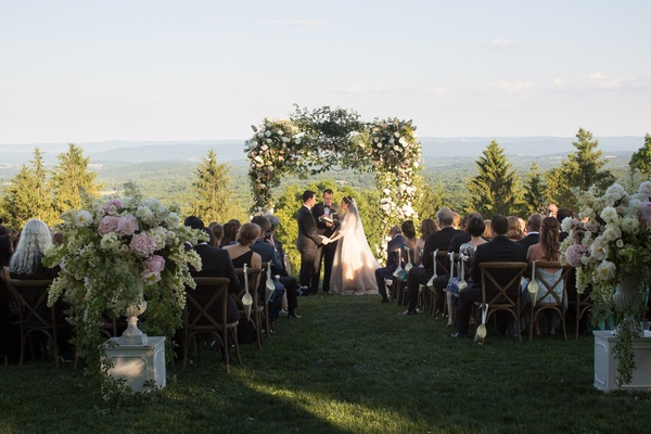 mountain, forest wedding ceremony with arbor of greenery